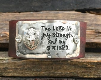 The LORD is my strength and my SHIELD.  Psalm 28:7. Hand stamped soldered Leather Cuff Bracelet