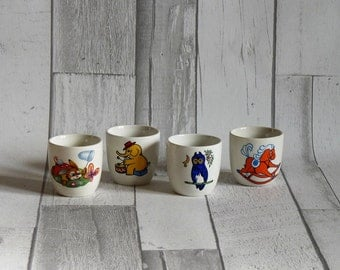 Four Vintage Children's Egg Cups with Animal Decoration