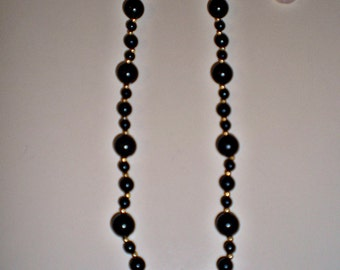 Ladies Vintage 70's Pretty Black Beaded Necklace with Gold Tone Spacers 24 Inch