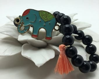 Turquoise Elephant Charm on Jet Black beaded flexible bracelet Mini Coral Tassel.