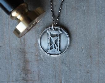 Hourglass wax seal pendant