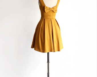 JANUARY | Golden - mustard yellow bridesmaid dress with bow. vintage inspired cocktail dress. mod retro dress with full skirt + pockets