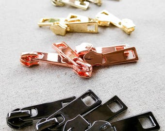 4 Zipper Sliders/Pulls for Size 5 Nylon Zippers. 6 Colours. For Nylon Chain/Continuous Zippers. Nickel Free. Long W/ Cutouts. Aus