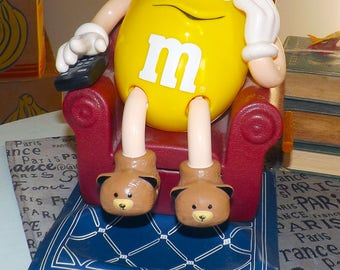 Vintage (c.1990s) M&M's Candy Dispenser featuring Mr. Yellow in his Lazy Boy with the TV remote in hand and his bear slippers on!