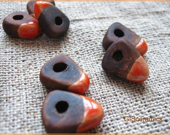 7 triangle handmade ceramic beads. half-glazed beads.