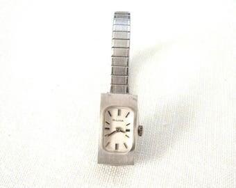 "Bulova Ladies mechanical wind up wrist watch. 17 Jewel 10k Rolled Gold Bezel, Swiss movement. Size 5.5"". Runs well . Keeps good time."