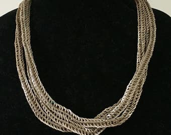 Extra long, heavy, textured silver toned chain necklace.