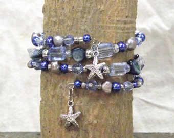 Beautiful Blue Ocean Theme 3 Loop Memory Wire Bracelet With Grey Freshwater Pearls, Blue Shell and Silver-tone Starfish Charms