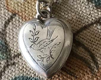 Delicate silver heart pendant engraved with a little bird on a branch, vintage