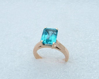 on sale gold and blue Topaz ring-Genuine blue Topaz set in 10 carat yellow gold.