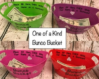 Bunco Bucket:  Perfect accessory for your Bunco Kit.  Use it to collect your Entry Fees. You choose- Purple, Pink, Green and Red