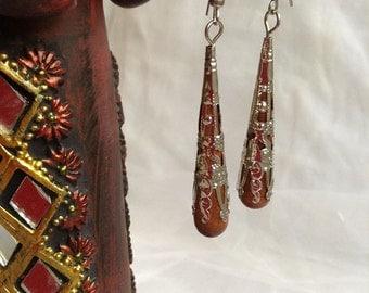 Wooden handmade dangle earring with light metal filigree work.
