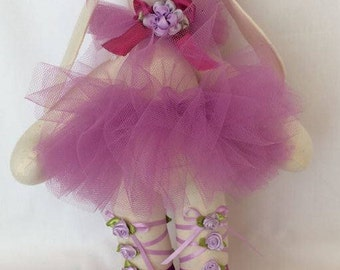Ballerina bunny in lilac colored tutu with satin ribbons and rosette trim
