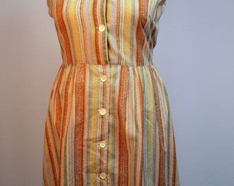 1970's sleeveless summer dress with button up front in brown tones
