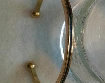 Avon gold bracelet with black center