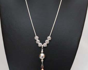 Round silver plated snake chain with 8mm round filagree beads and rose gold tassel charm