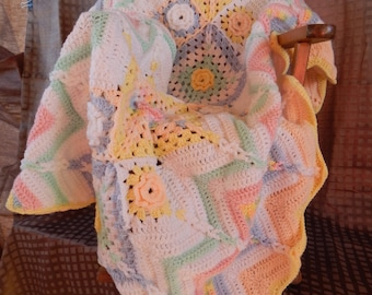 Crocheted granny square ripple baby blanket