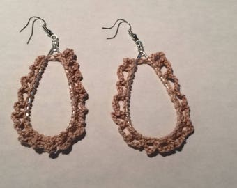 Handcrafted crochet teardrop earrings in a loop pattern.