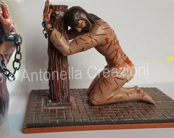 Jesus scourge, sculpture representing the tortures suffered by Christ, painted by hand not to be missed.