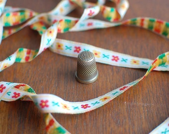 Vintage jacquard ribbon with a floral pattern embroidered in yellow, red and green over white 10mm width - Sold by the metre