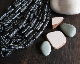 black tube bone beads, with a  carved designs,  natural Irregular look,  boho exotic beads 19 to 24mm long  (10 beads) 6db3-7