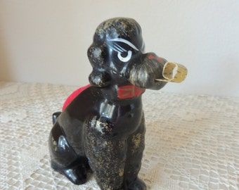 Unusual Gold Trimmed Black Ceramic Poodle Dog Pincushion. Made in Japan Black Ceramic Dachshund Metal Tape Measure With Red Pin Cushion.