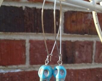 Long Turquoise Magnesite Skull Earrings