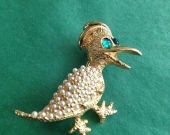Adorable vintage green eyed bird brooch