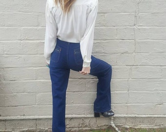 Retro 1970s bohemian high waisted jeans flare jeans dark indigo denim deadstock hippie hipster jeans size small size xs vintage jeans cool
