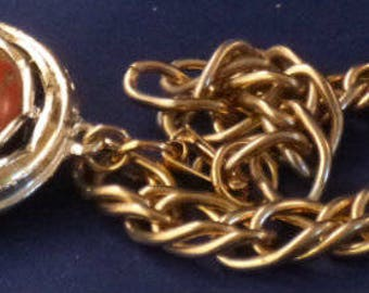 Vintage Gold Tone Bracelet with Round Variegated Red Charm, 1960s