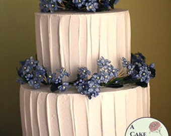 """Fake cake with rustic icing for home staging, dessert buffet decor, and wedding centerpieces. 5"""" and 7"""" tiers, two tiered faux cake."""