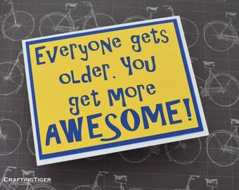 Everyone gets older. You get more AWESOME- Yellow card with Blue lettering - blank inside- Birthday card