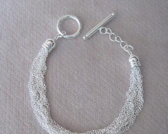 "Ten Strands of Silver Summer Light  Petite Chains in a 7-1/2"" Bracelet"