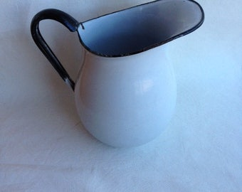 Beautiful vintage white and blue rimmed enamel pitcher