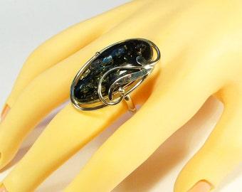 Natural green Baltic amber ring.