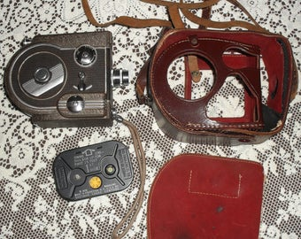 Revere Eight Model Seventy Seven Regular 8mm Silent Film Cartridge Movie Camera with Cartridge and (most of a) Case! Working!