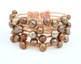 Green brown freshwater pearl bangle with beige wrapped wax cord, wire bangle