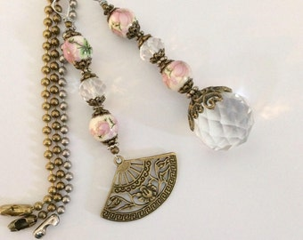 Pink light pull or ceiling fan pull set. Bronze, silver or gold ball chain pull. Ceramic and Crystal pulls. Lady's Victorian fan pull chain