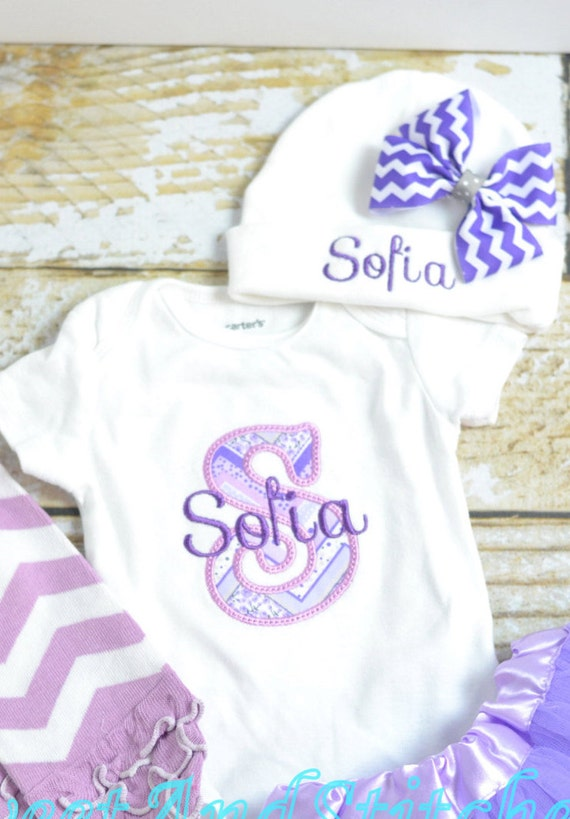 monogrammed newborn outfit in purple baby girl take home