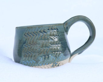 aqua green mug with zig zag pattern
