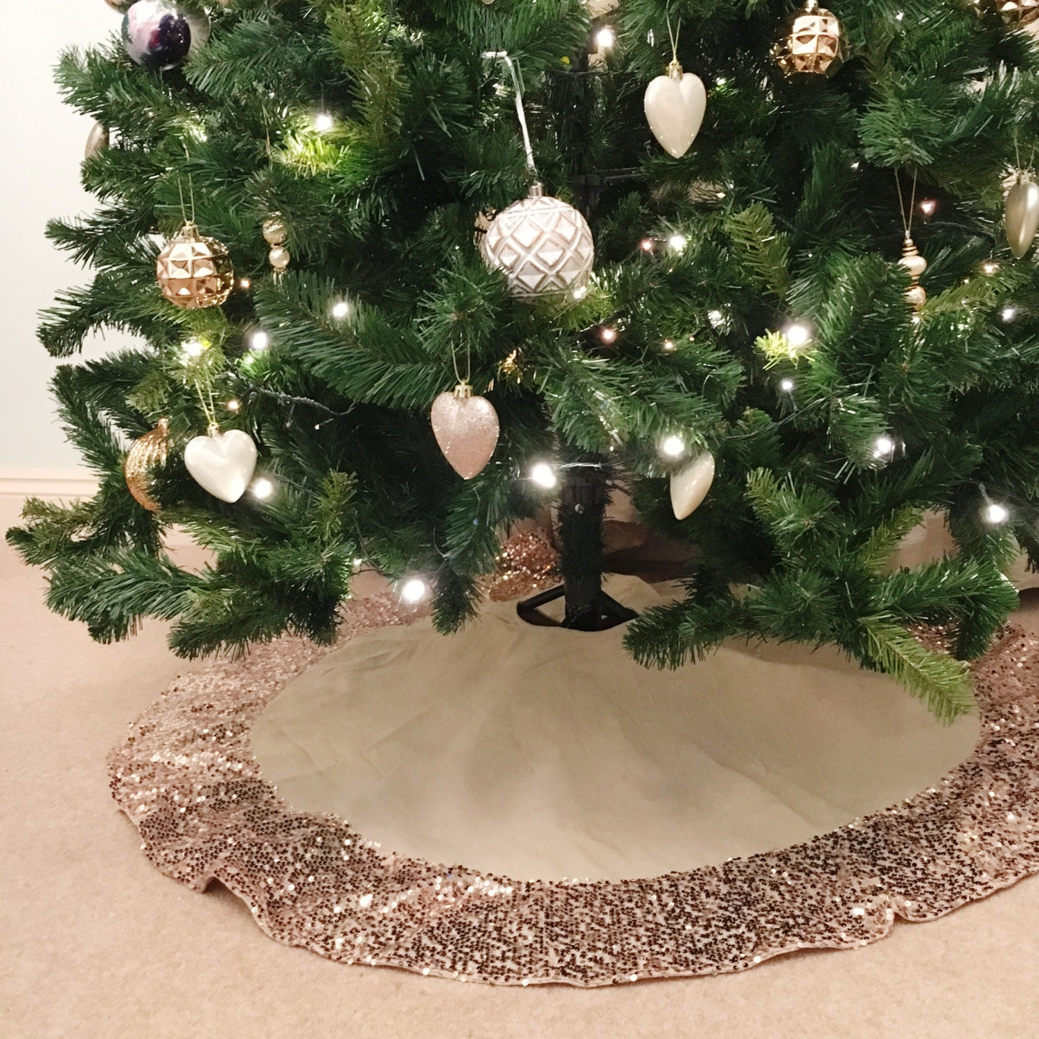 Christmas tree skirt with rose gold sequin trim made from