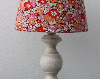 White lamp in shabby chic style with a very flowery lampshade