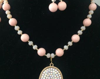 Long pale pink beaded necklace with pave, aurora borealis pendent in gold tone with matching earrings statement, fashion, Kendra Scott style