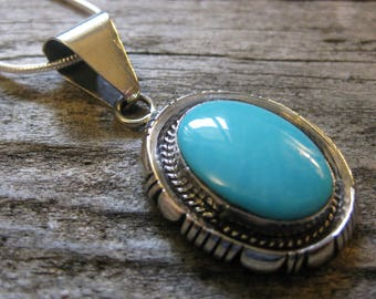 signed Navajo rare collectible SLEEPING BEAUTY TURQUOISE pendant, necklace, sterling silver. Cloudless summer sky blue.