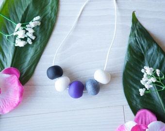 Sadie—Handmade necklace with black, white, purple and granite polymer clay beads