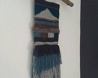 Wool woven wall hanging.