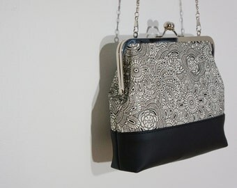 Charlie clutch (white embossed floral print & black faux leather)
