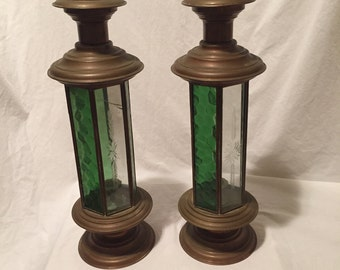 pair of copper and glass hanging wind resistant lanterns with ring finials green and clear glass