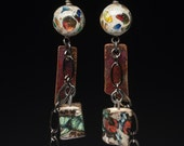 Singularity earrings, artisan beads in lampwork glass and rustic ceramic dangle down a central chain, cyberpunk jewelry