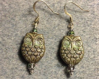 Brownish green Czech glass owl bead earrings adorned with irridescent green Chinese crystal beads.